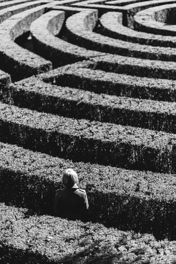 person standing in a maze