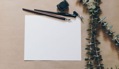 image of a fountain pen and notepaper